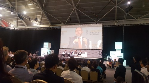 Brad Garlinghouse, CEO of Ripple, breaking down altcoin hype for the audience. Photo credit: Lucia Ziyuan