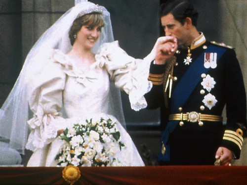 Prince Charles kisses the hand of his bride Princess Diana on the balcony of Buckingham Palace on their wedding day.