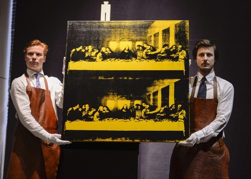Employees at Bukowski Auction House display Andy Warhol's 'Last Supper', in Stockholm, Wednesday, May 14, 2014. The painting was sold at Bukowski Contemorary auction sale for 6.8 million euro (9.3 million dollars). (AP Photo/Per Larsson, TT news agency) SWEDEN OUT