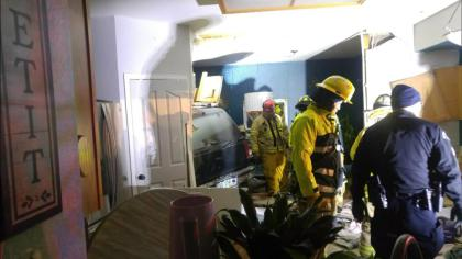 crash What If? Mom And Daughter Escape Harm As SUV Crashes Into Their House
