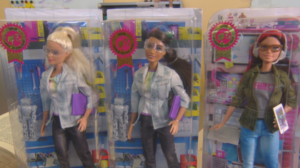 better barbie 10pkg frame 360 CU Professor Helping Shape Barbies Future Image On The Job