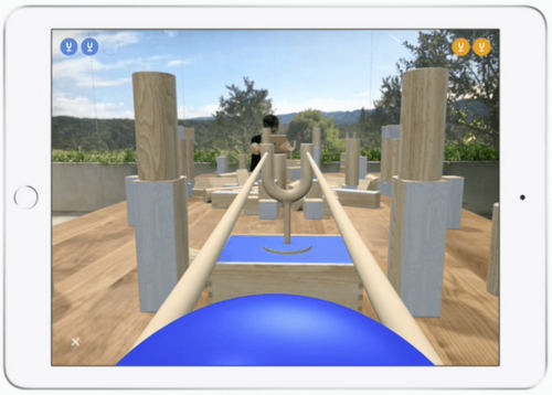 Another multiplayer game, with AR objects on top of real objects. Seen from Player Two's tablet. (Image from Apple)