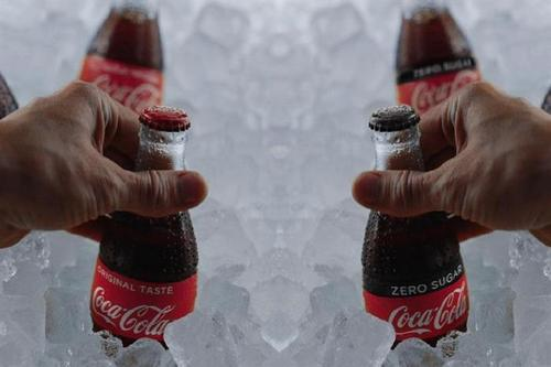 Coca-Cola reviews media planning and buying